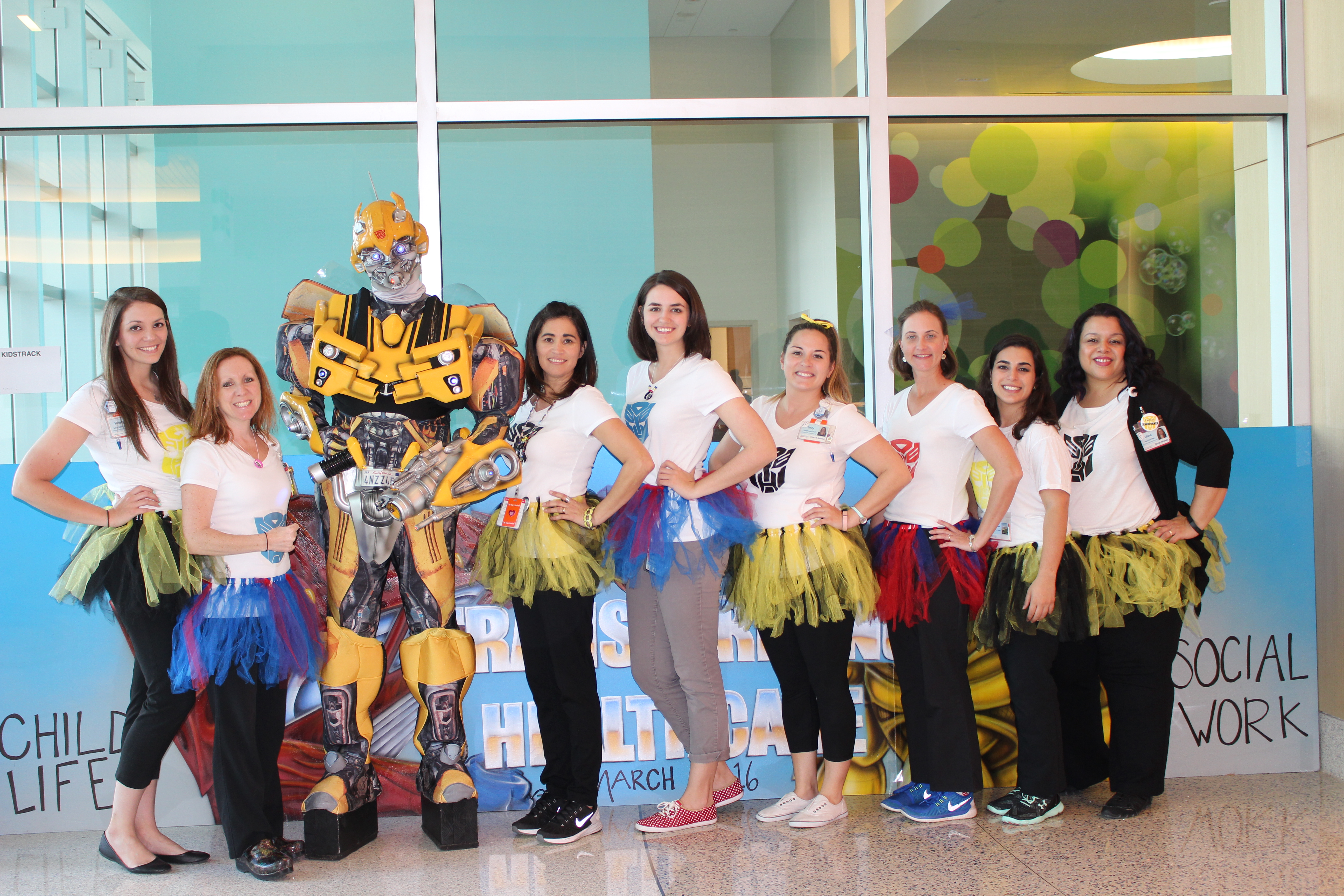 Nemours Children's Hospital Child Life and Social Work team with Bumble Bee
