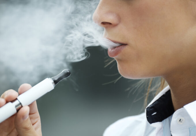 Teen girl smoking e-cigarettes