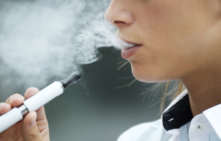 Teen girl smoking e-cigarettes