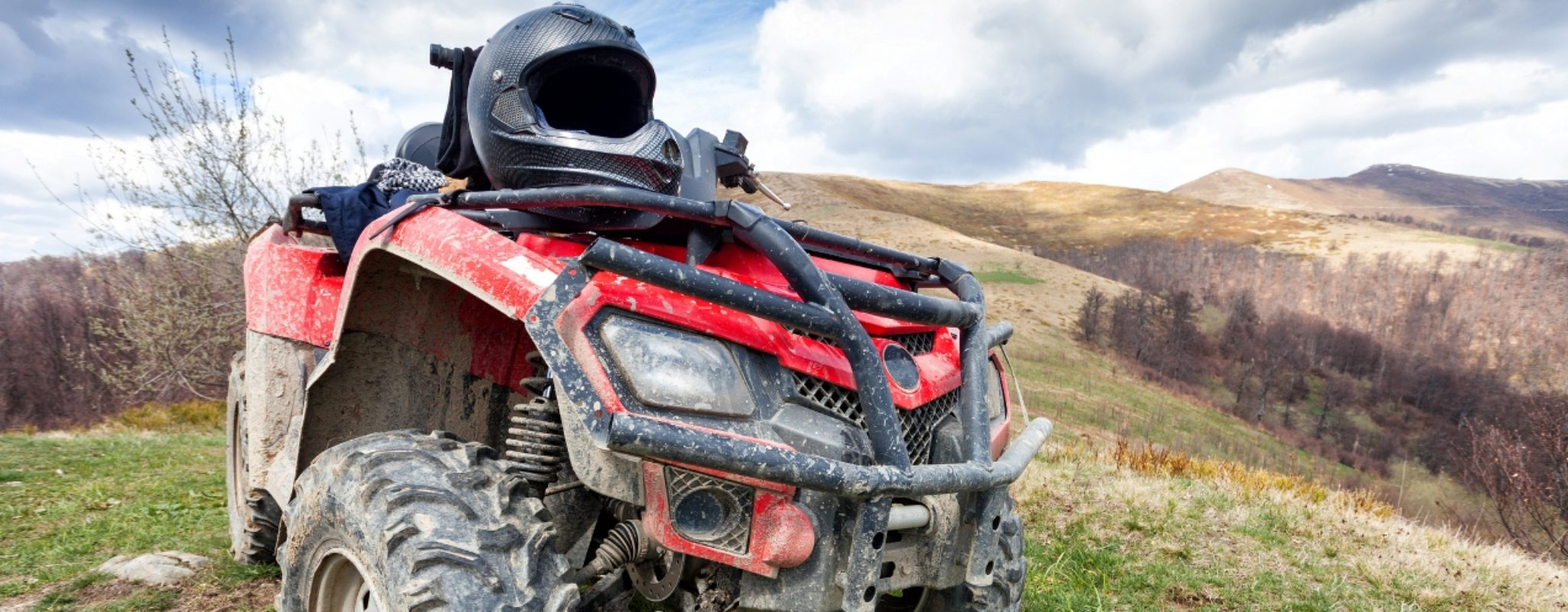 An ATV with a helmet shows the importance of ATV safety