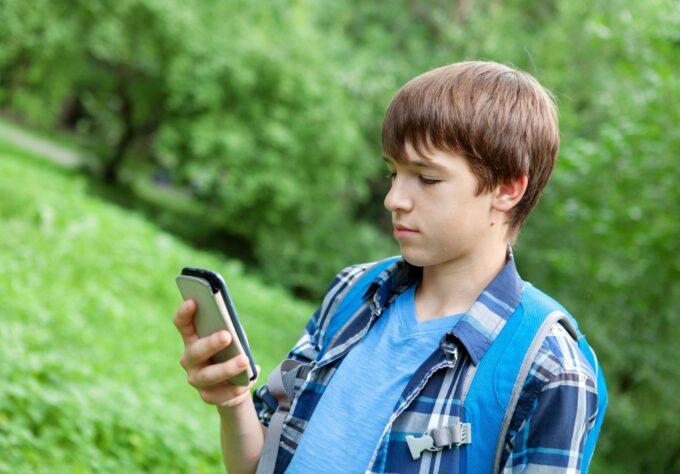 Teen playing Pokémon Go