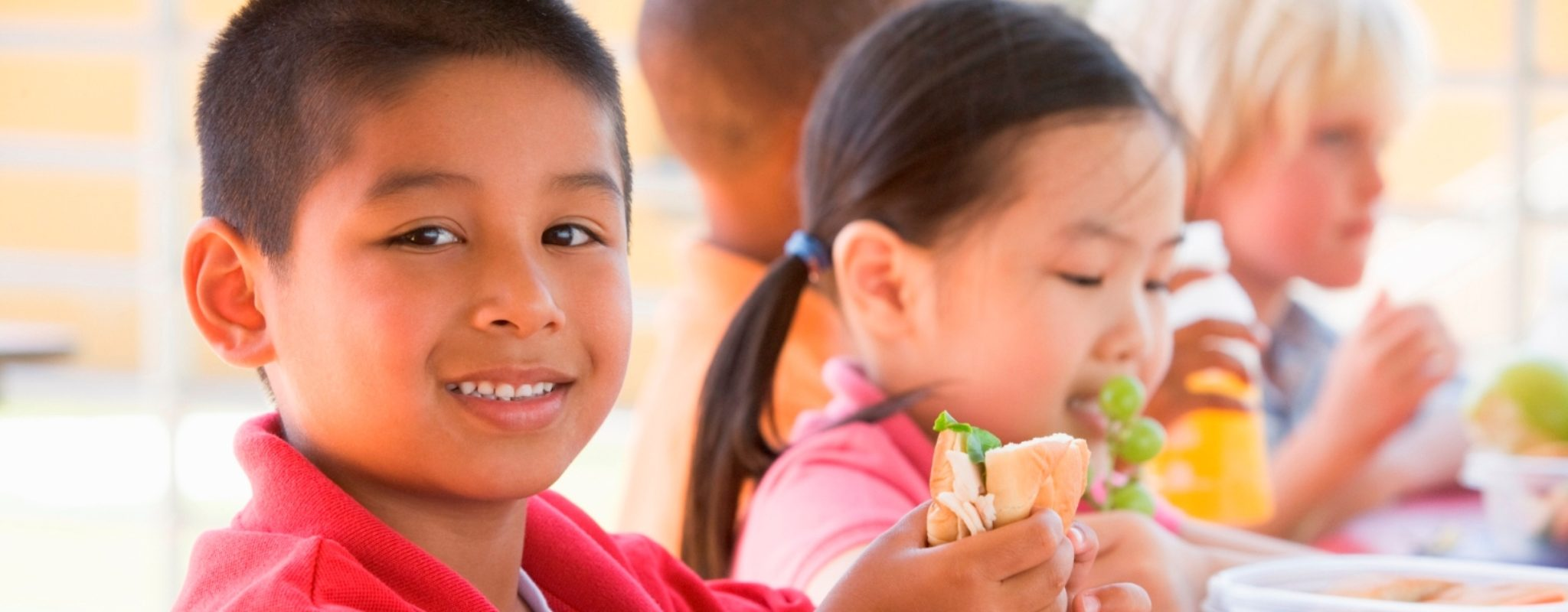 children eating healthy school lunches