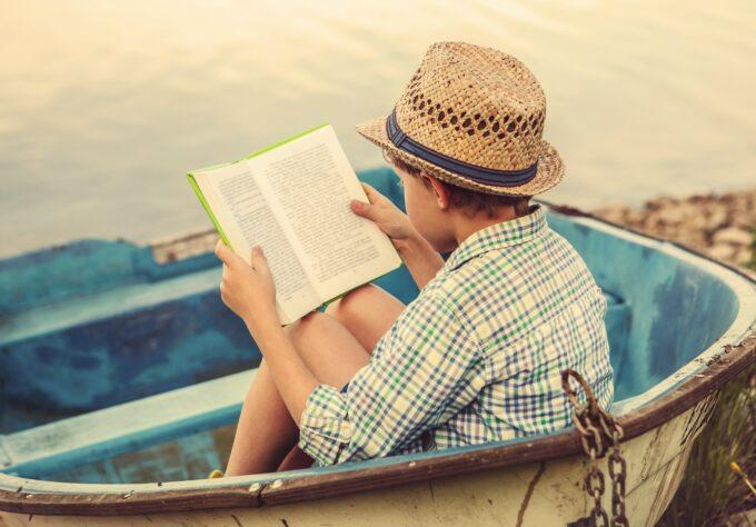 Boy reading, preventing summer slide.