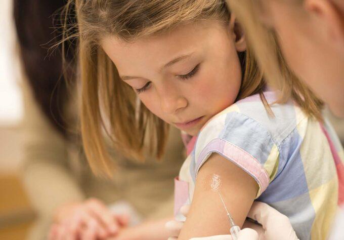 Girl receiving vaccines