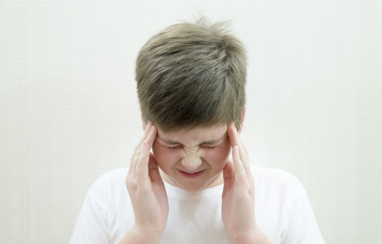 A young teenage boy with a headache.